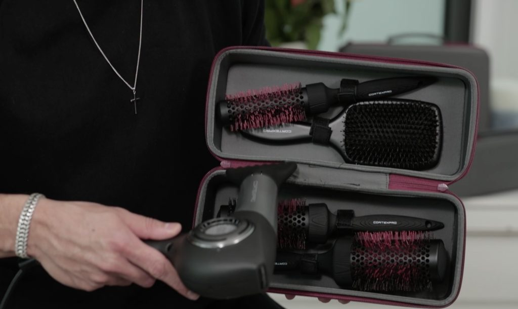 Antonio Estrada holding the new brush kit, while demonstrating color-changing red bristles as hot air hits the brushes.